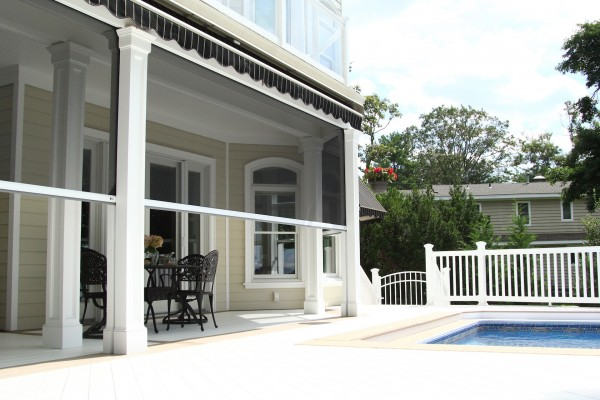 Motorized screens for large openings such as patios and porches