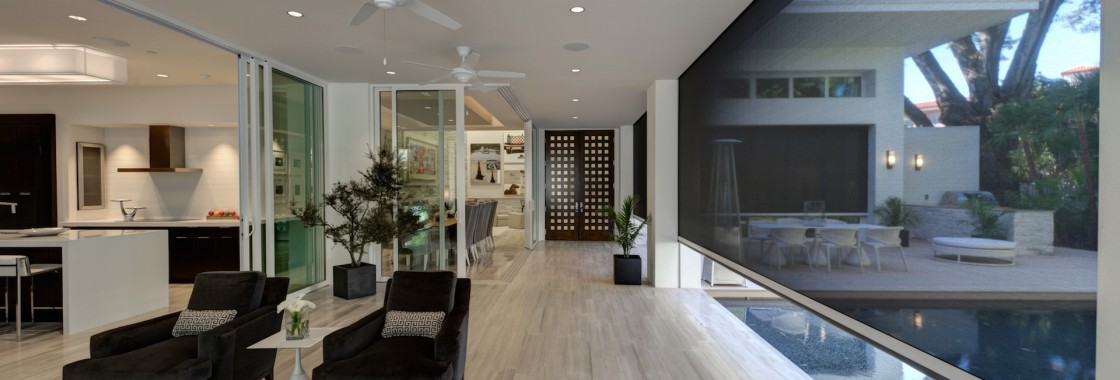 The New American Home 2012 (Orlando, Florida). Designed by Phil Kean Design. Phantom's motorized recessed Executive screens offer shade, retracting out of sight when not in use.