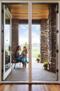 Lady and child enjoy there Phantom retractable screen door in Aldergrove, BC.