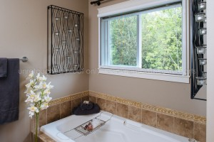 Privacy mesh allows retractable screens to provide the seclusion needed for a bathroom in the city