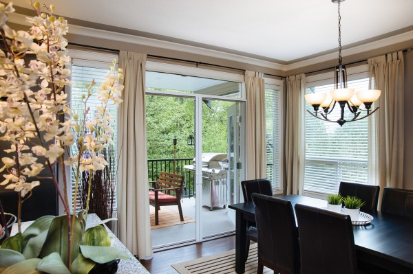 Chilliwack home with door screens that retract from sight.