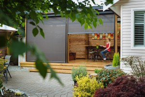 Make your deck an extension of your home - block the sun and bugs with Phantom motorized screens for porches and patios