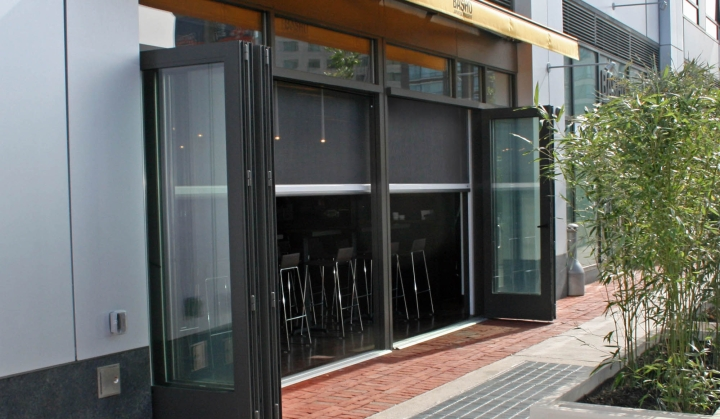 Restaurant patio screened in with Phantom motorized screens - keep the bugs out!