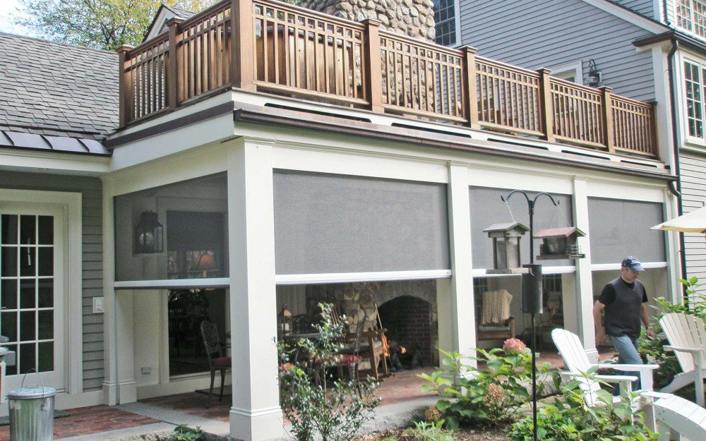 Classic New England home, with screened in porch by Phantom Screens
