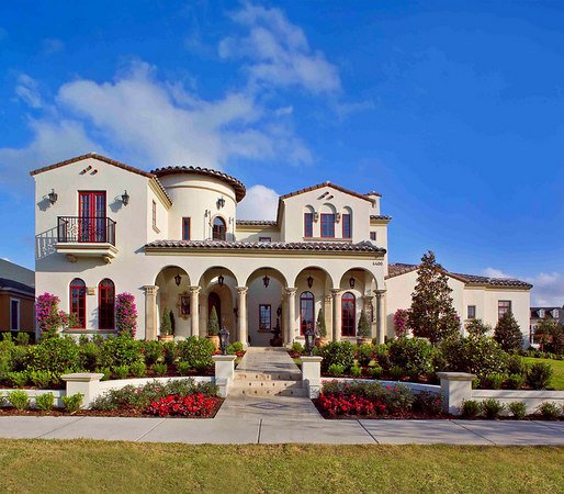 Mediterranean style home with arched Phantom Screens.
