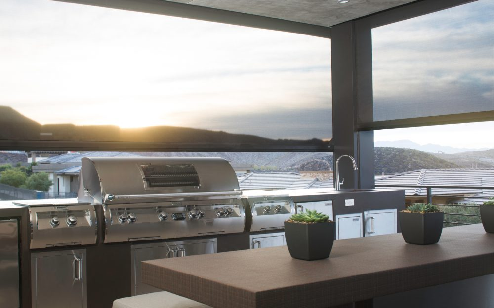 Picture of a patio with heaters and Phantom Screens that keep temperatures comfortable.